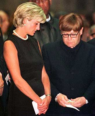 Diana with Elton John at funeral of Gianni Versace