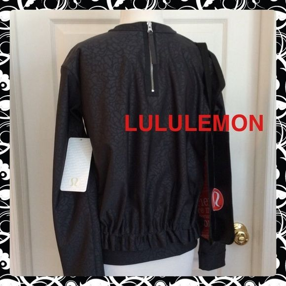 "SALE❤️New LULULEMON ""Departure Top"" Black Pullover Awesome Brand New LULULEMON ""Departure Top"" with Tags. This is a Stunning Charcoal Patterned Crew Neck Top!  A Chic look with a super Cute Ruffled Back and stylish back Zipper. Soft and stretchy fabric is designed for comfort and mobility. Hidden ventilation and two zippered pocket. Come with Lulu Bag lululemon athletica Tops"
