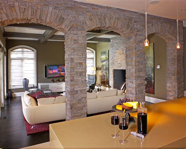 Family Room With Great Stone Arches.