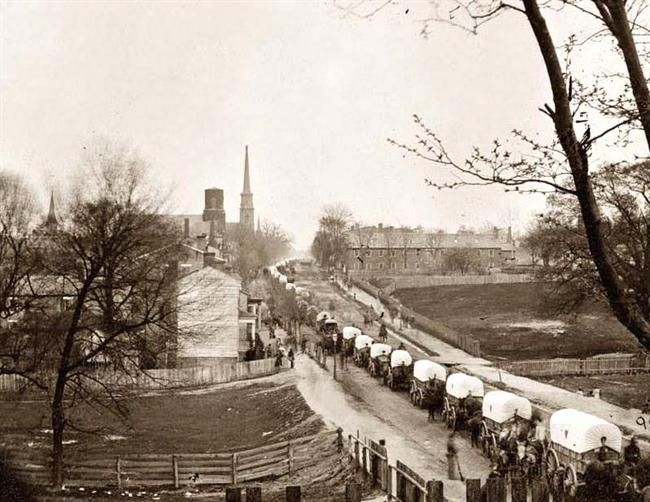 Here for your enjoyment is an exciting photograph of Petersburg, Virginia The first Civil War Federal wagon train entering the town. It was made in 1865 by Reekie, John