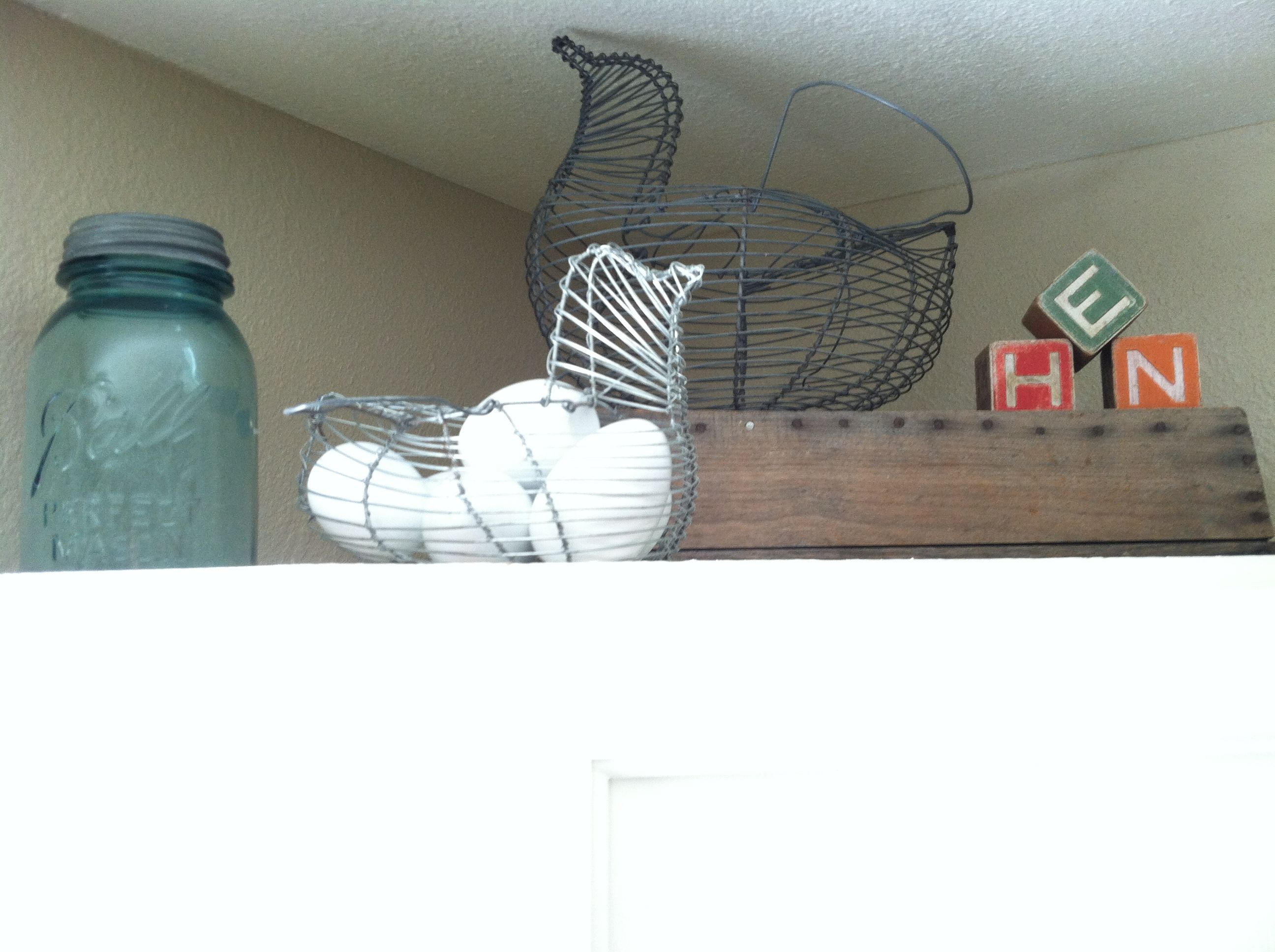 Wire baskets above kitchen cabinets...egg baskets and ...
