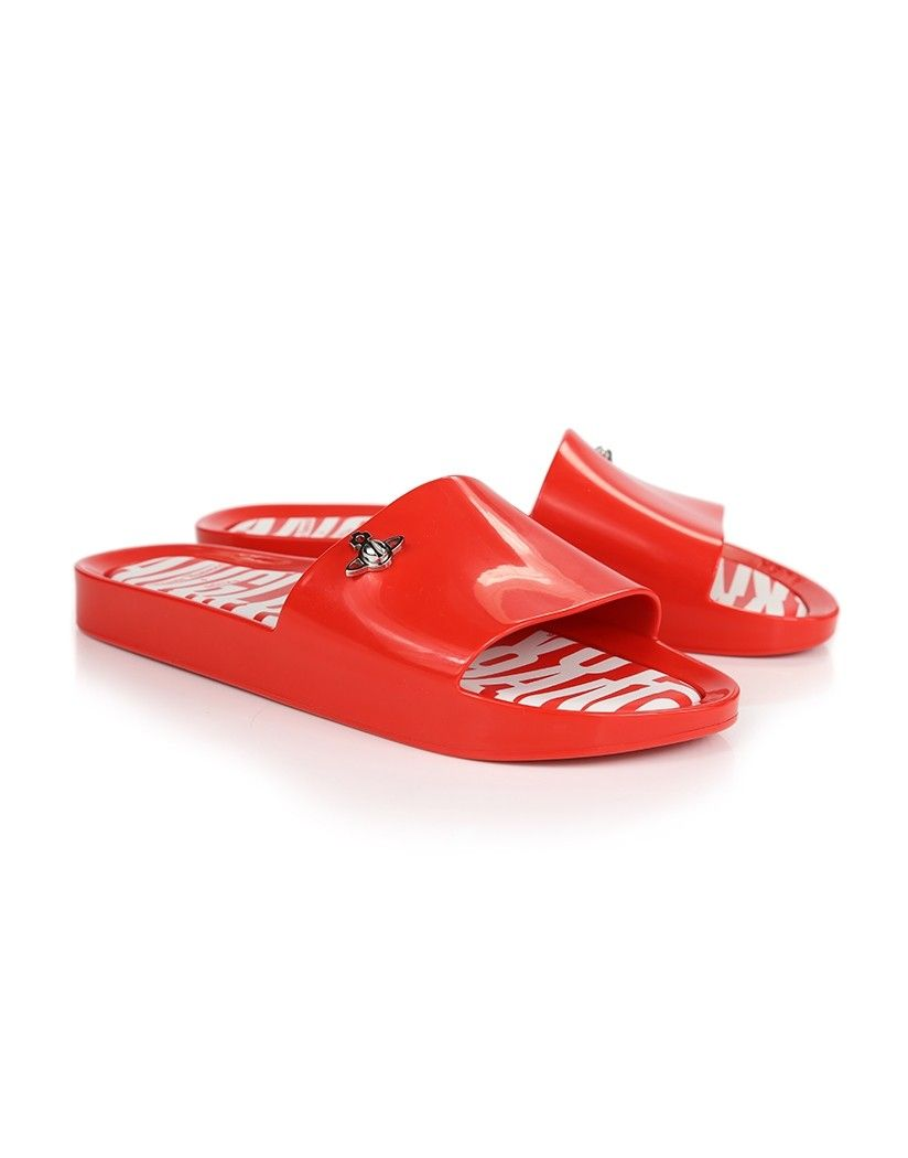 9f7725048f07 The classic Melissa Beach Slides have been given a quirky Vivienne Westwood  makeover. Crafted from