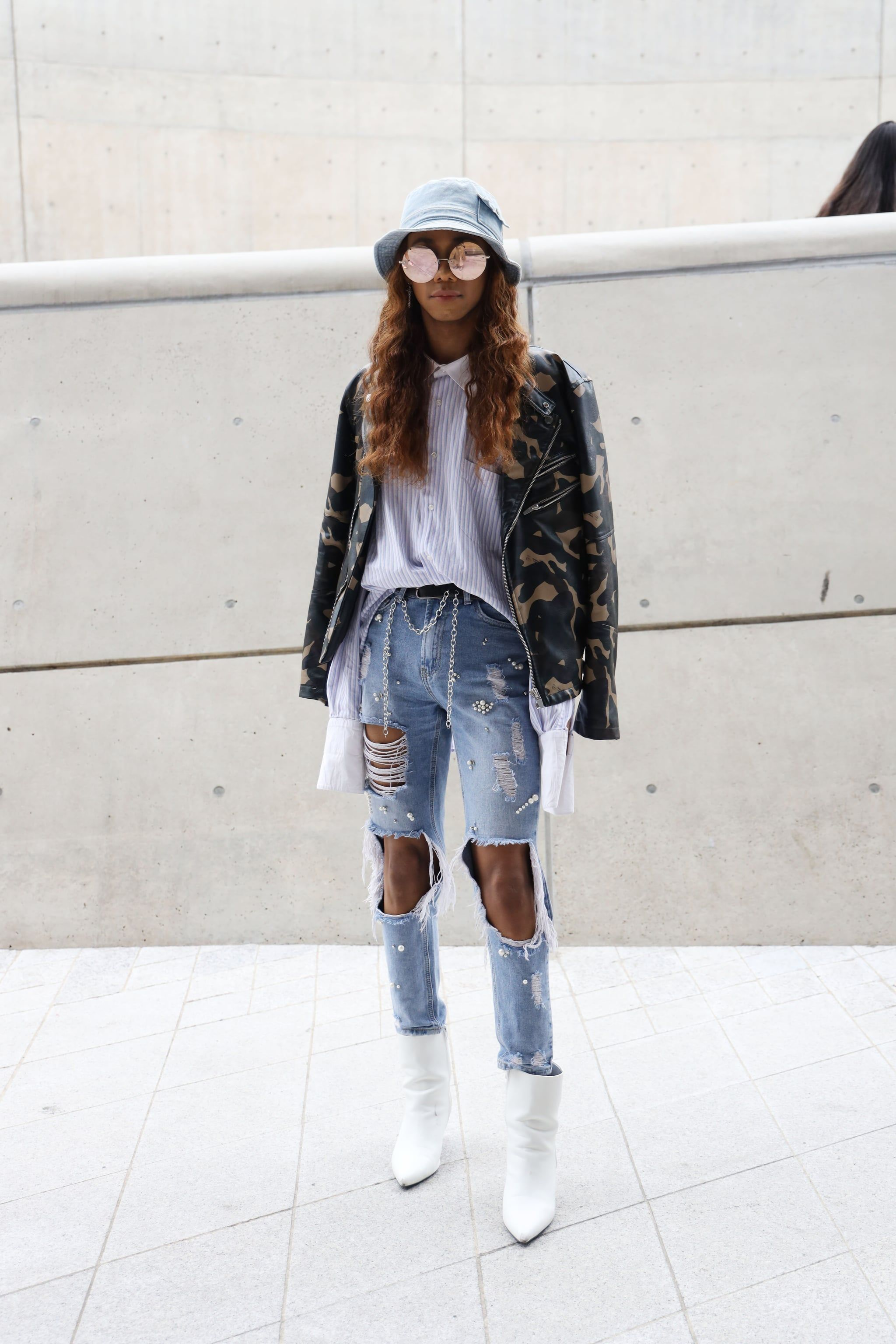 74b734c7448ea Edge up distressed jeans with a camo jacket and coordinating bucket hat.