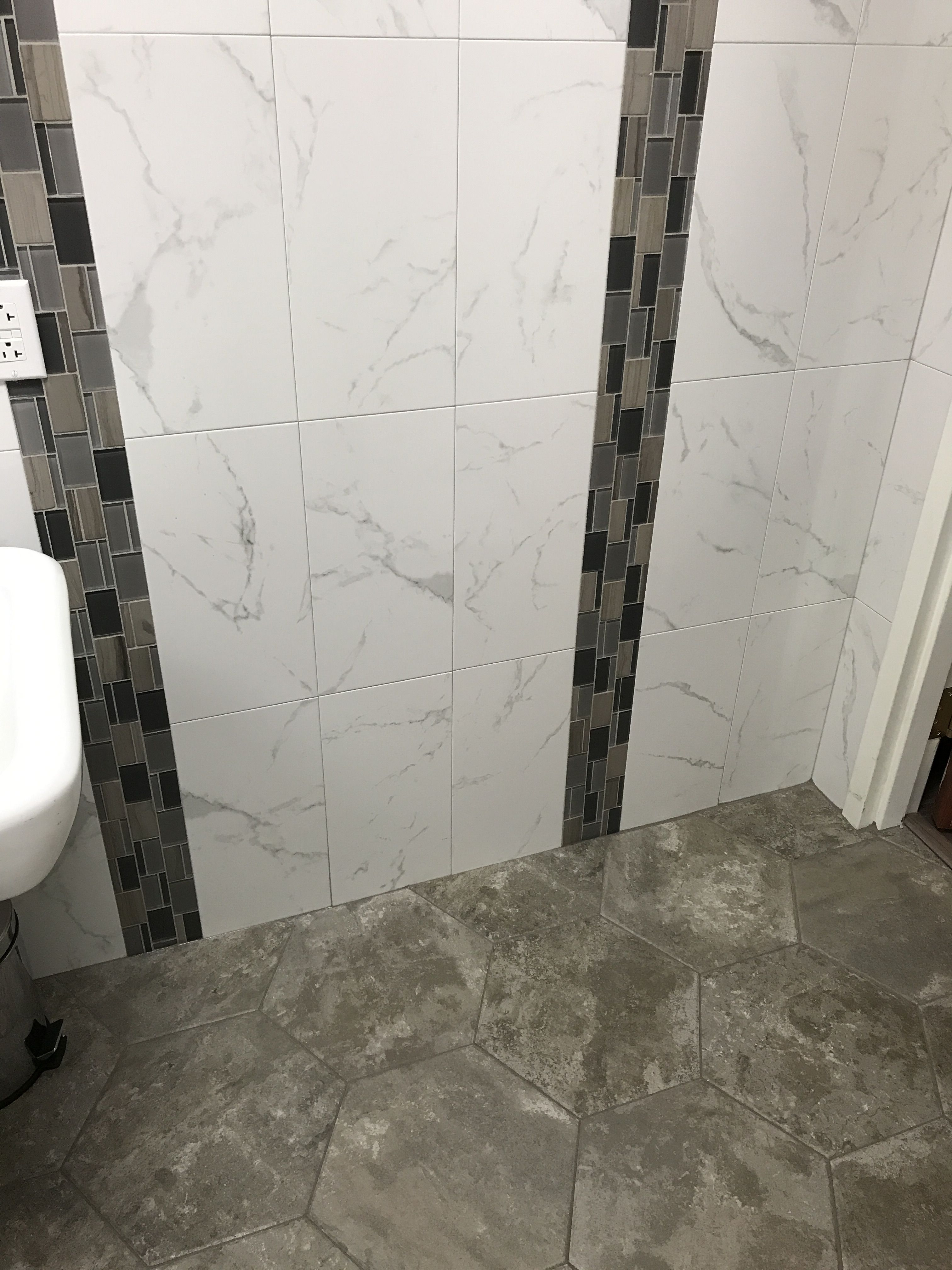 Porcelain wall tile that looks like marble with glass and stone