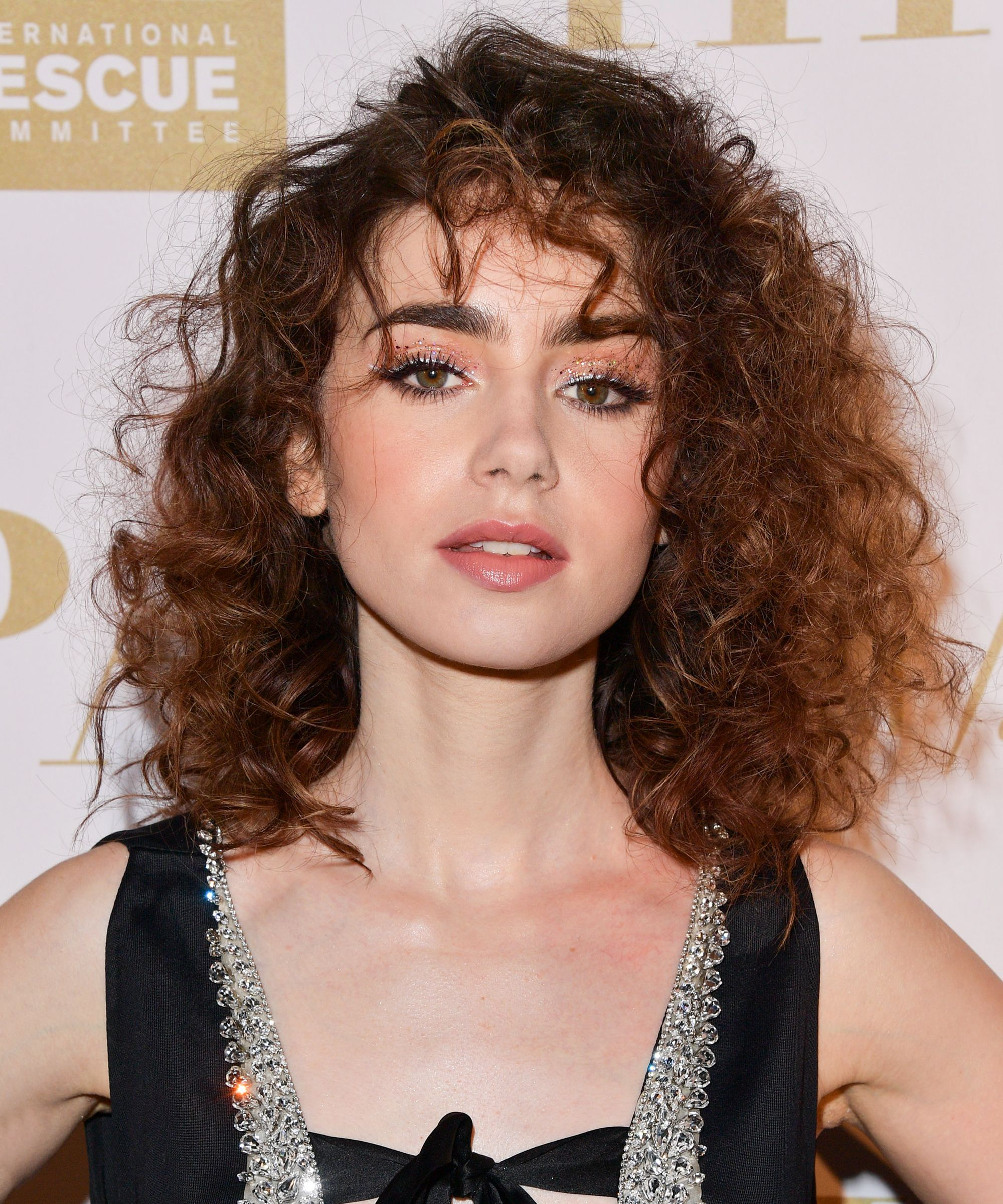 Daily Beauty Buzz Lily Collins Brings Back the 80s Perm