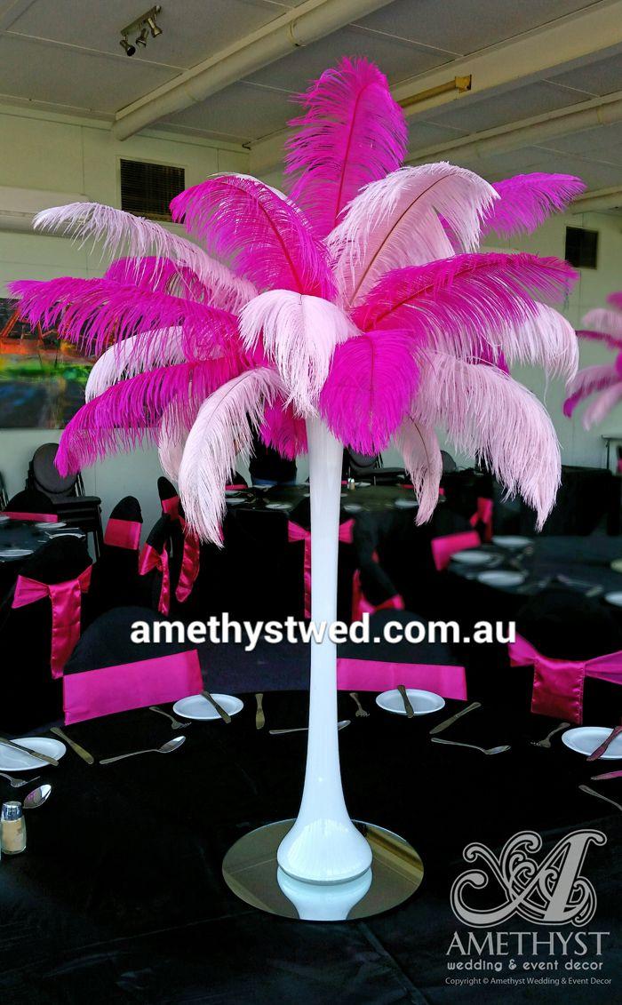 Fuschia & soft pink feather centrepiece on tall white eiffel vase ...