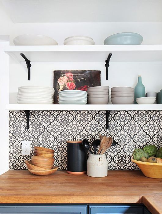 patterned tiles in the kitchen, blue kitchen cabinets, wooden worktop, open kitchen shelves