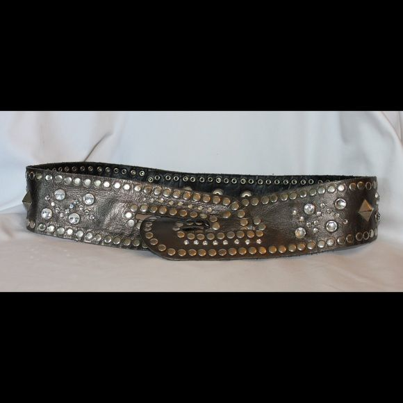 Studded imitation leather belt Cool studded leather belt that makes any tunic looks cool.  Snaps in back and front has loop design. Color is a metallic pewter.  Belt will go from 28-37 inches. Accessories Belts
