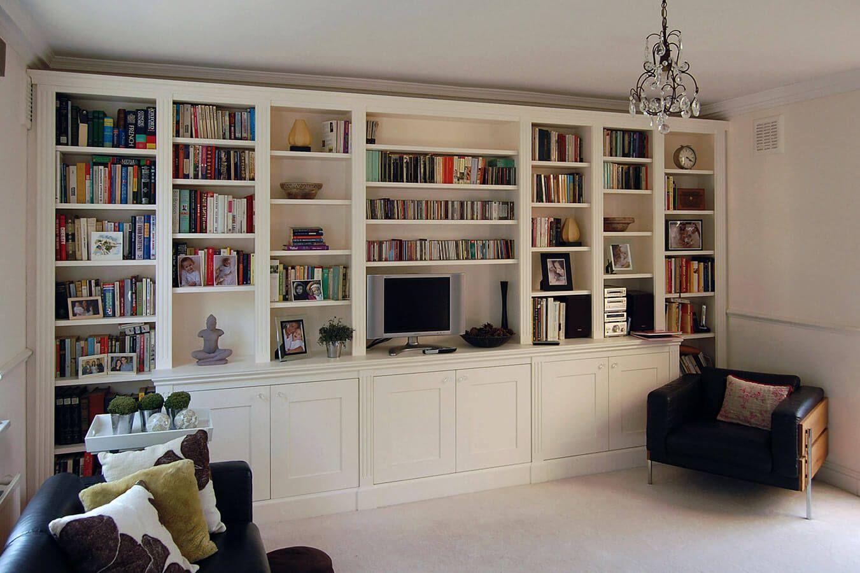 delightful white living room gray sofas suspended shelving | Breakfront bespoke cupboards and shelves | Shelving units ...