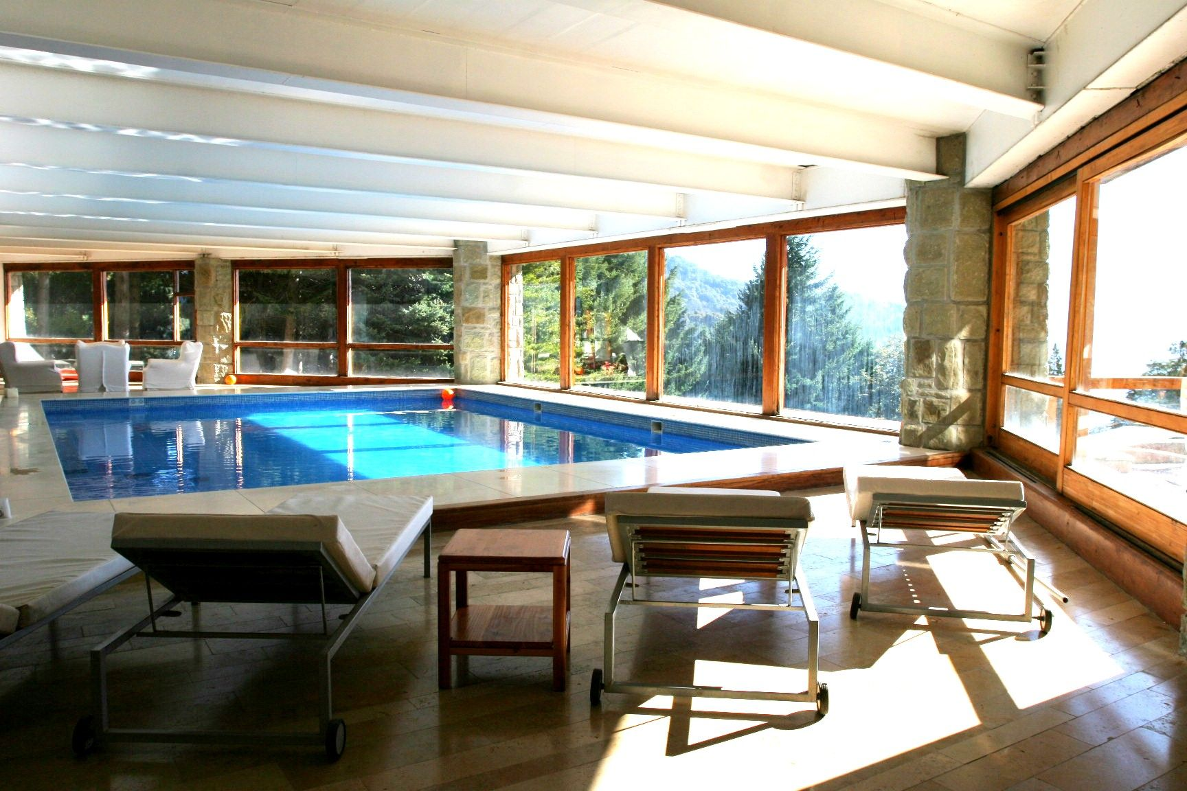 The pool. A perfect place for submerging into the weekend and waiting for a stunning #sunset over the lake. #NahuelHuapi #Bariloche
