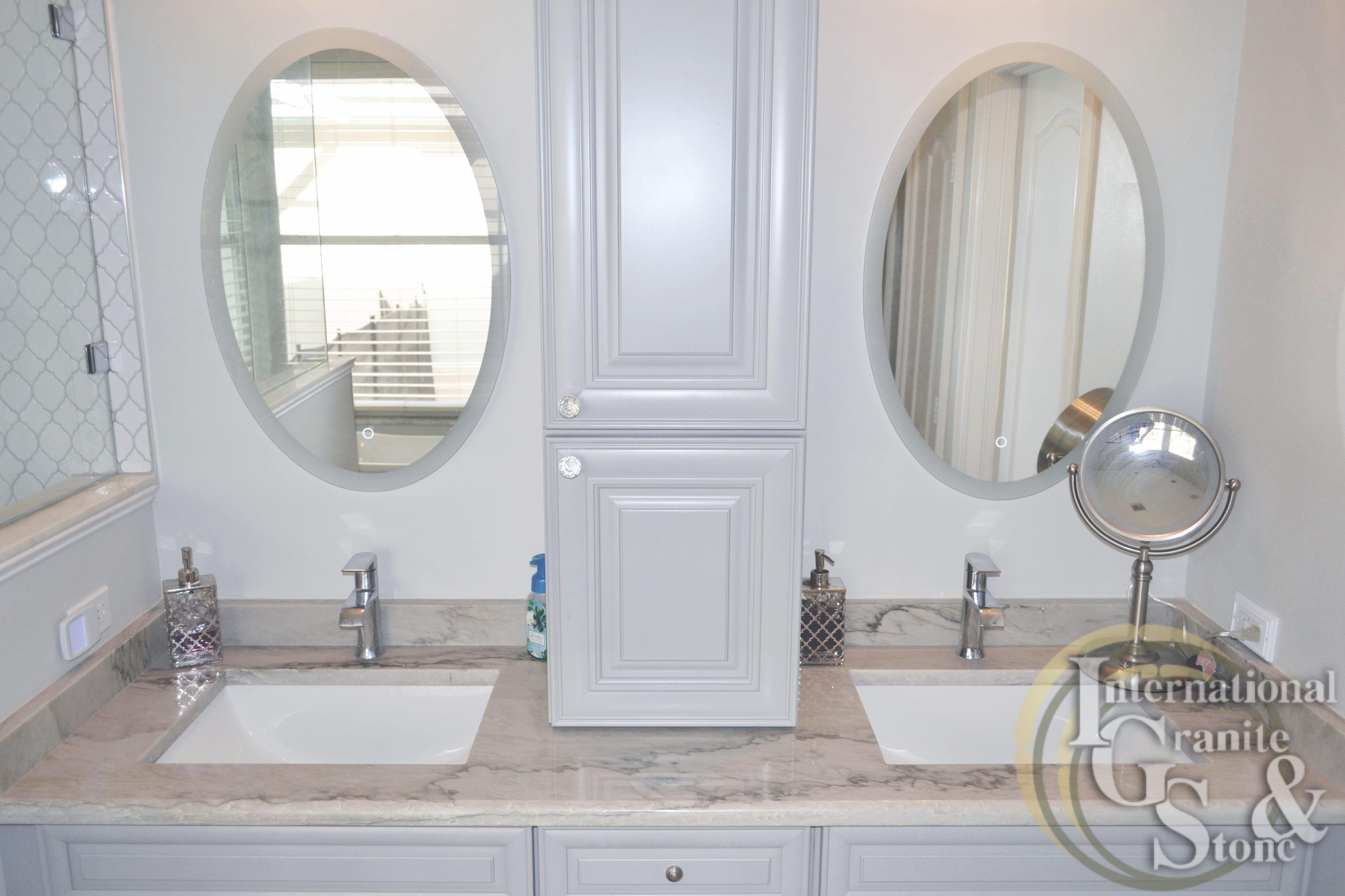 A recent calcatta quartzite master bathroom installation