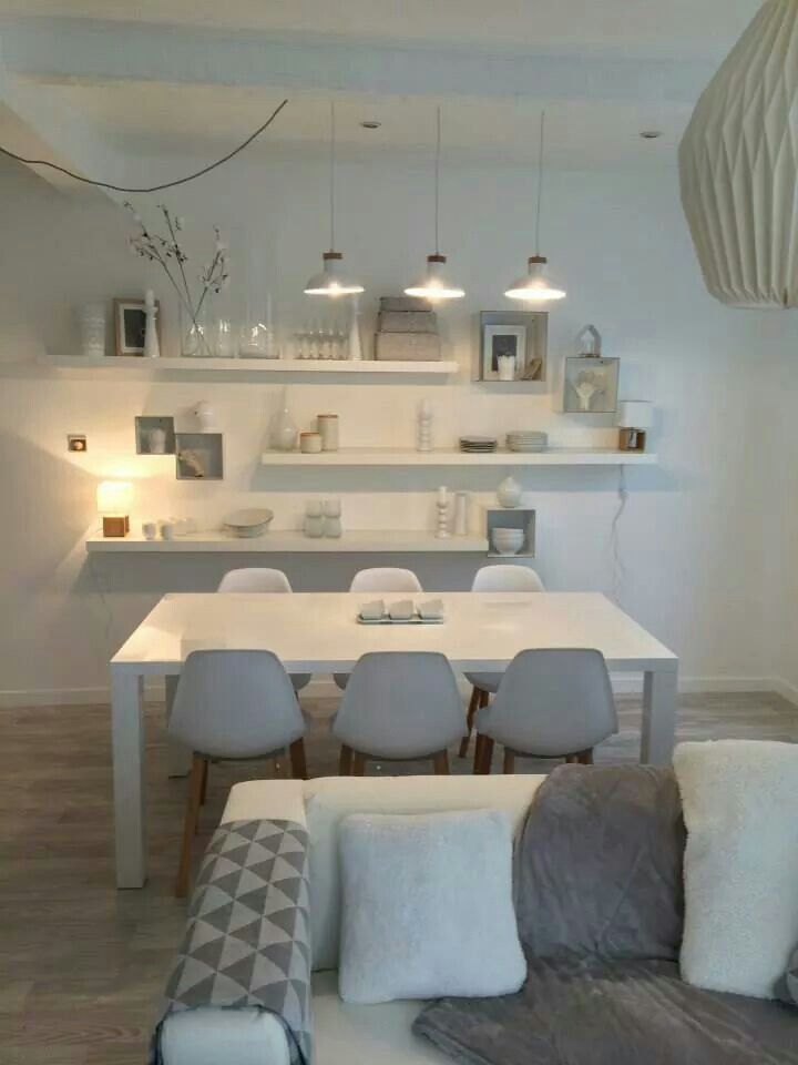 Simple White And Light Grey Dining Area With Pendant Lighting. The  Asymmetrically Set Shelves And