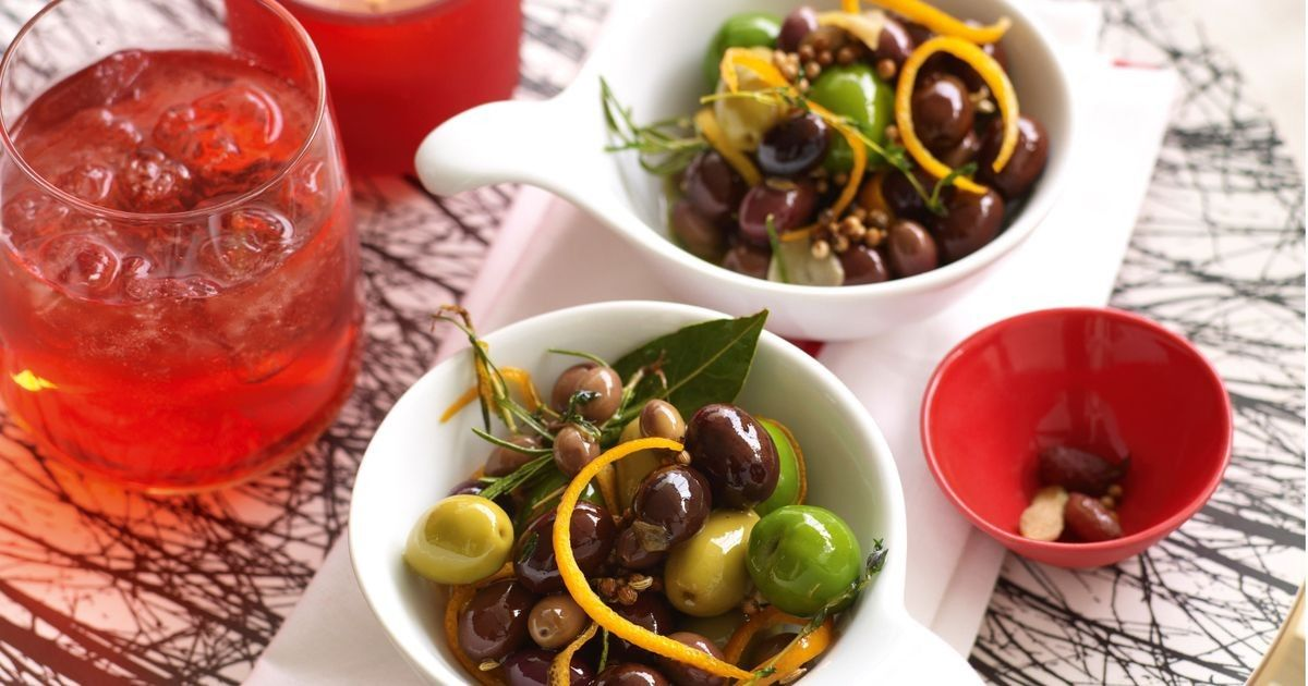 Forgo creamy dips or cheeses and serve these with drinks instead. Find a food store with a good olive selection and get a mix of large and small, skinny and fat, black, brown and green. Unpitted olives always taste better than pitted – just put out another small bowl for the stones when serving.