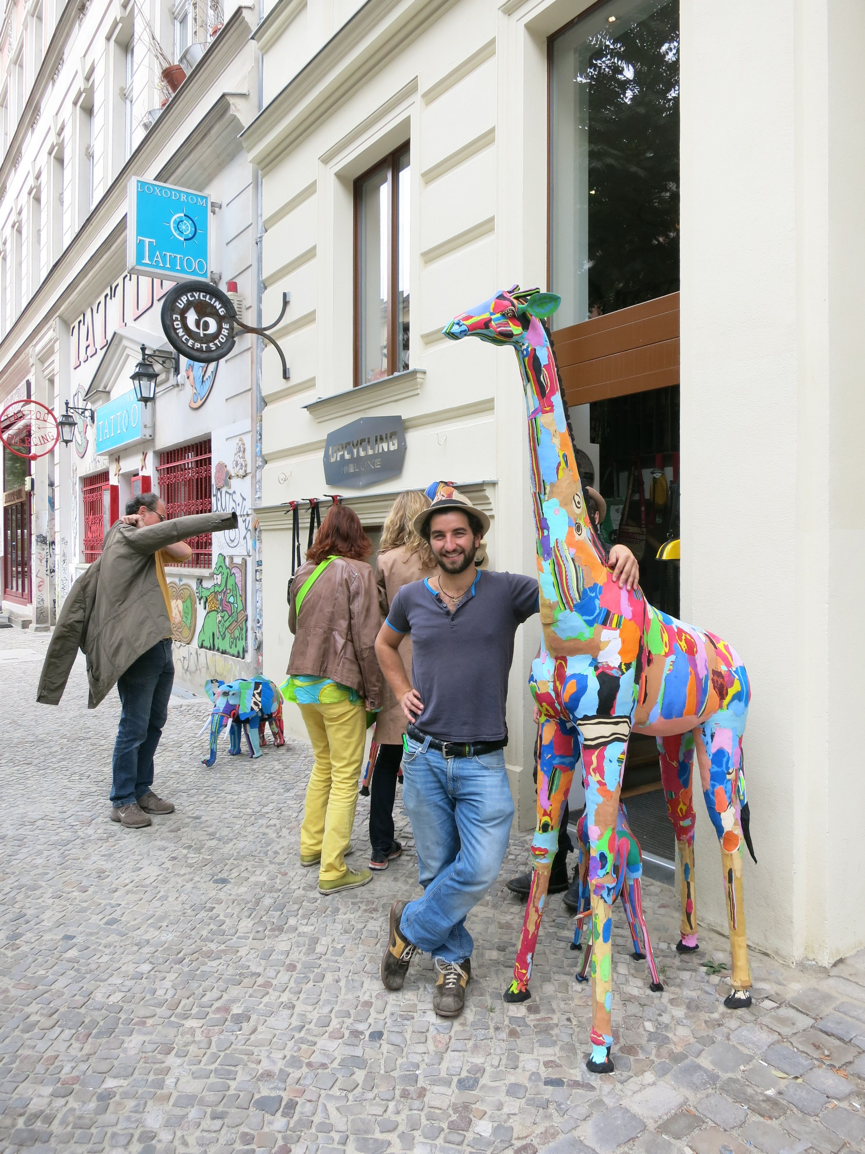 Upcycling Berlin tallest giraffe made from flip flops in all of europe in front of
