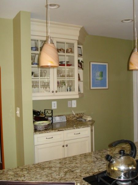 stacked crown molding to fill extra space above cabinets ...