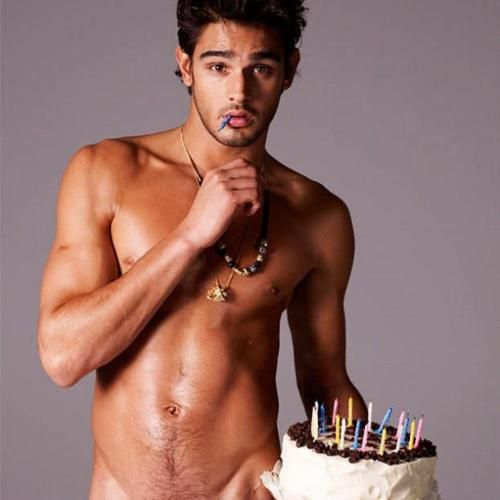 Hot shirtless dude frosts a cake and we don't know which is more droolworthy