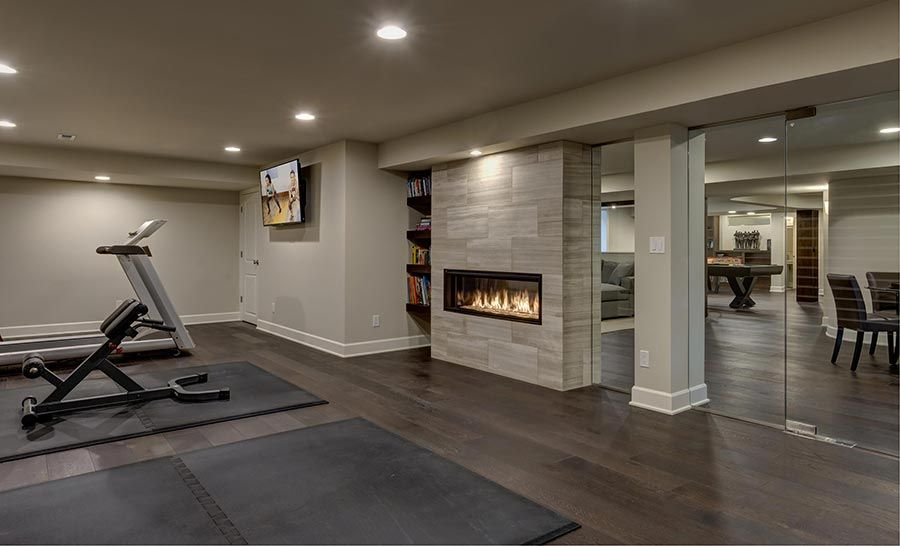 modern home gym basement space greenwich design ideas | basement fireplace gym | Basement fireplace, Workout room ...