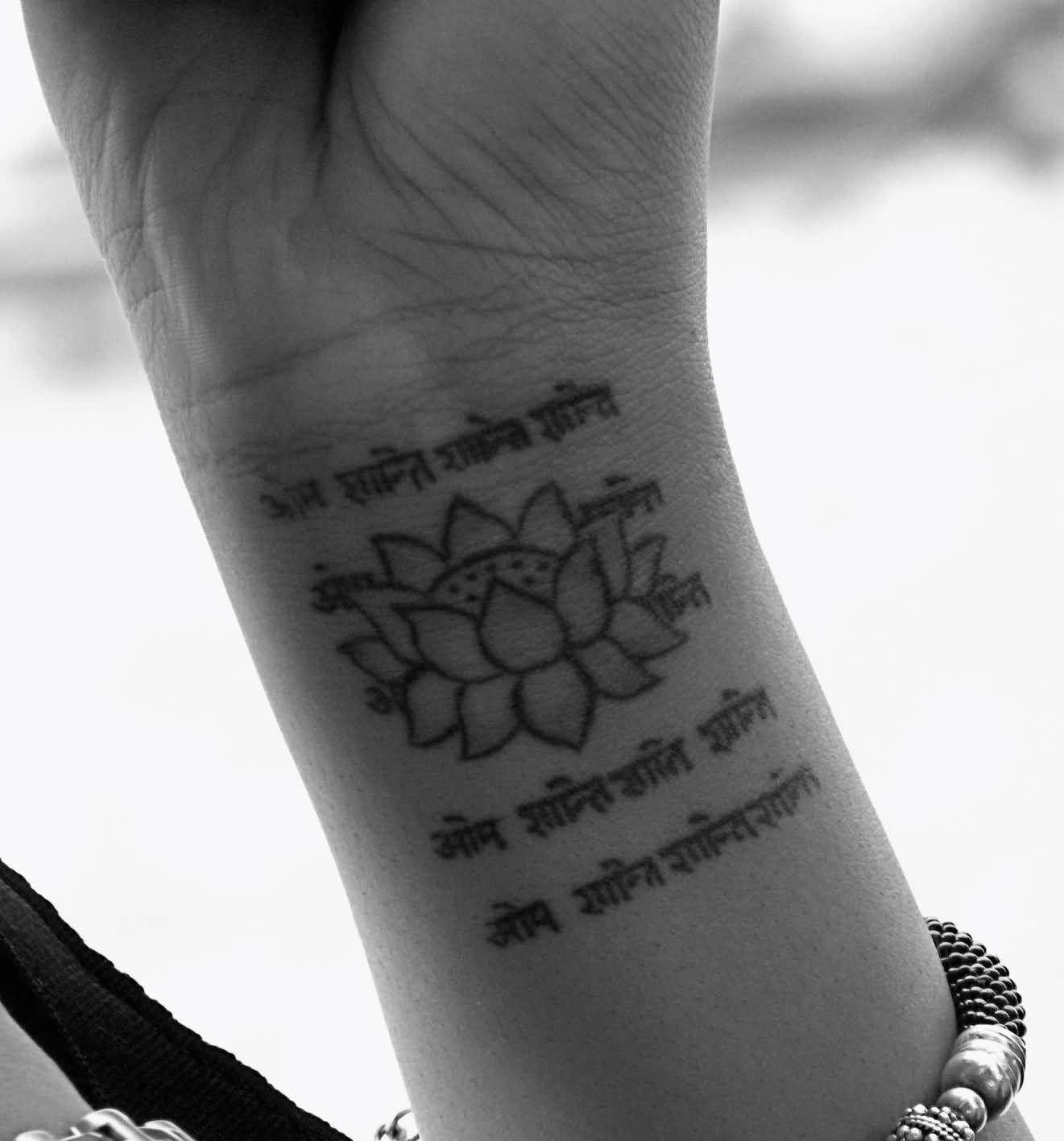 Lotus And Sanskrit Spiritual Tattoo On Wrist Sanskrit Tattoo Mantra Tattoo Tattoos