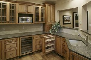 Learn How Much It Costs To Install Cabinets Custom Built Cabinets Kitchen Installing Cabinets