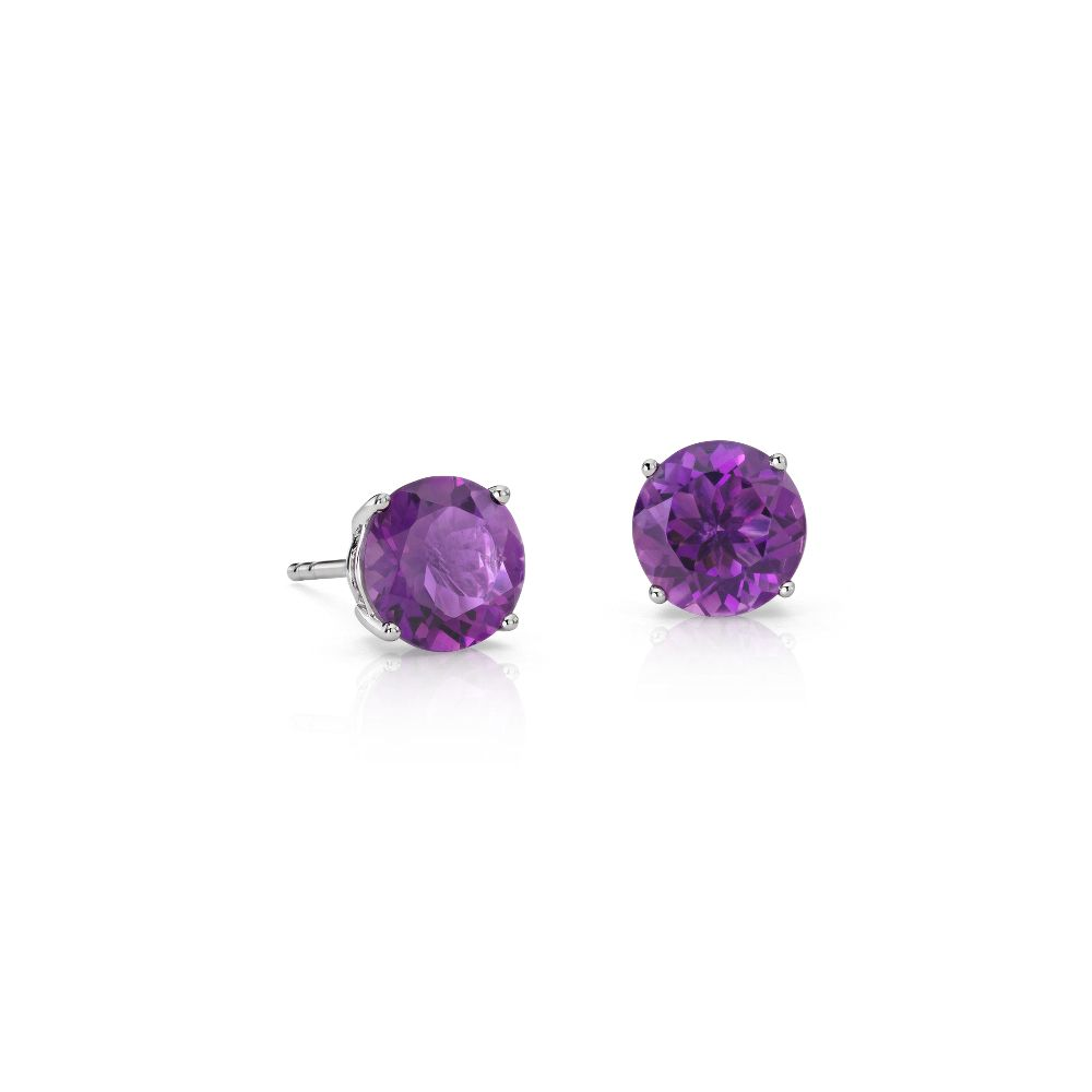 Amethyst Stud Earrings in 18k White Gold (7mm) from Blue Nile.  Sparkling and timely, these hand-selected gemstone earrings feature vivid purple amethyst gemstones set in 18k white gold four-prong settings.