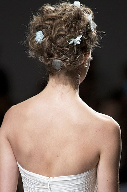 The Lazy Girl's Guide To Summer-Perfect Hair #refinery29  http://www.refinery29.com/no-heat-hair-styling#slide10  For curly hair, try: Twisted knotsInspiration: Zac Posen Tired of the same bun day in and day out? This romantic, voluminous twist is a refreshing change and still keeps your hair off the nape of your neck for sweltering afternoons.