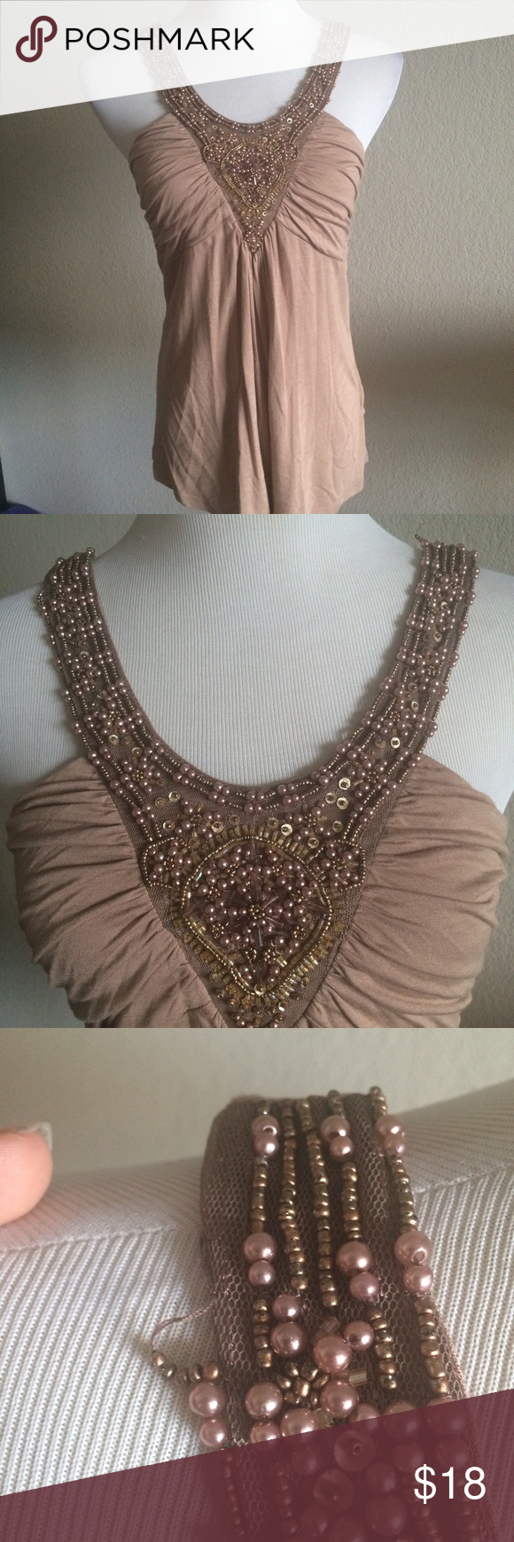 Forever 21 Beaded Taupe Sleeveless Top Art Deco Gorgeous tank from Forever 21 with glamorous beading. Only worn 2 times, cared for impeccably, never dried in a machine and is in perfect condition. The beads are tied off in a way that makes it look a bit like they are loose, but they are secure and in like-new condition; see photos, no beads lost!  Fits true to size for F21. Juniors sizing. Jersey stretch material. Comfy and flattering. Forever 21 Tops Tank Tops