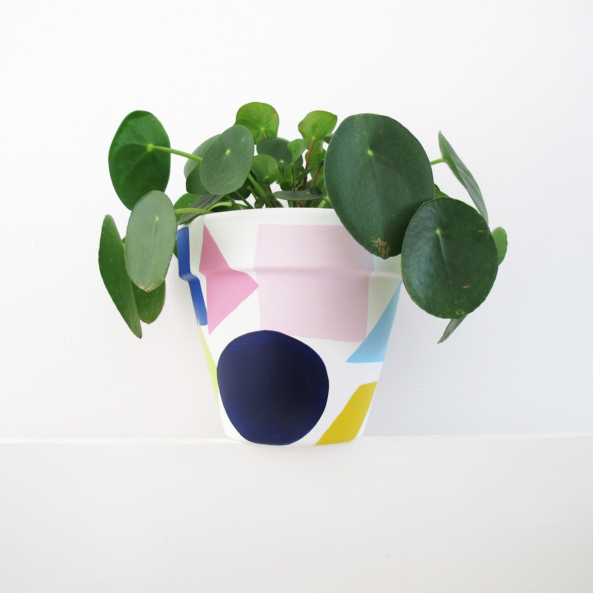A hand painted plant pot with lots of nice shapes and colours. Measures 13.5cm high, 15cm diameter. Sealed for both water and UV protection and safe…
