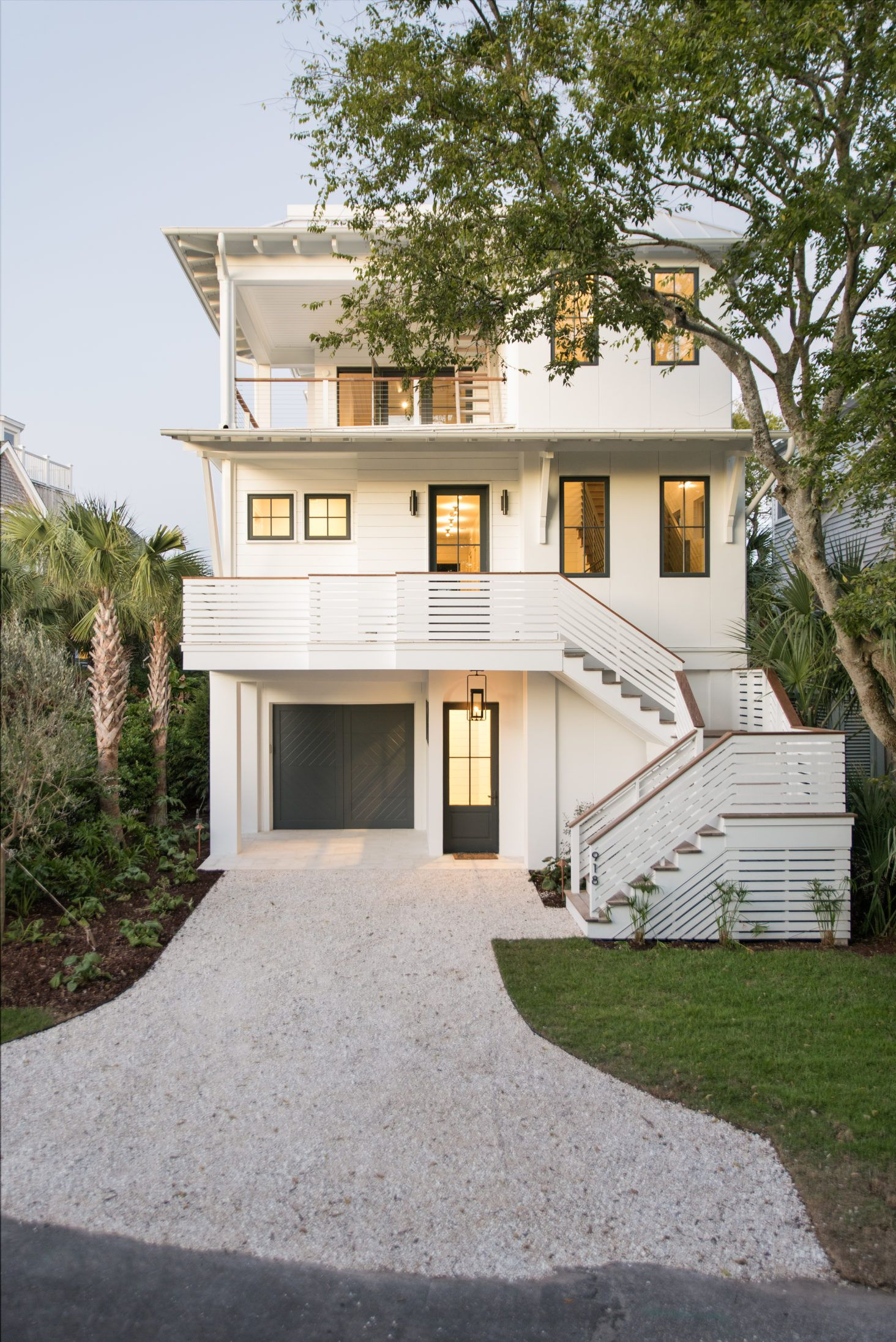 Beautiful 3 Storied White Home Exterior With Black Doors And Windows Barrow Building Group House Designs Exterior House With Balcony Beach House Exterior