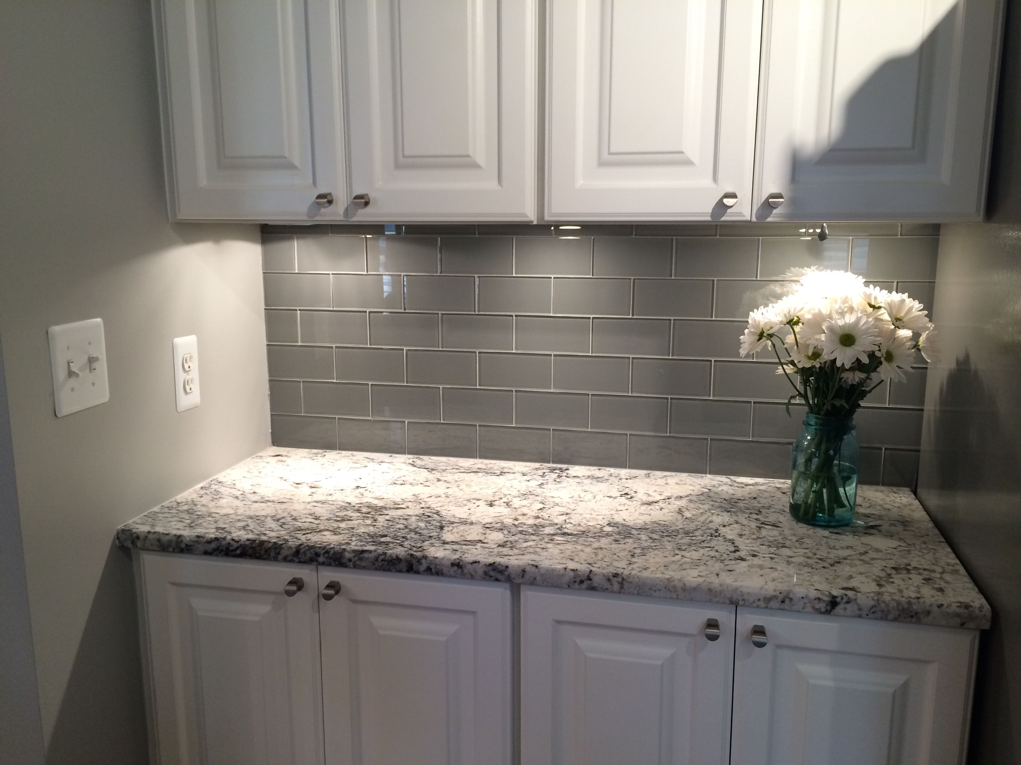 Grey glass subway tile backsplash and white cabinet for Glass subway tile backsplash