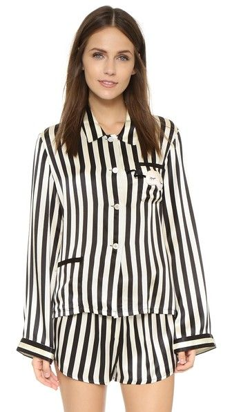 A striped Amanda Fatherazi x Morgan Lane pajama top in luxe silk, accented with a charming sleep mask appliqué. The perfect cozy holiday gift!   Morgan Lane Amanda Fatherazi PJ Top