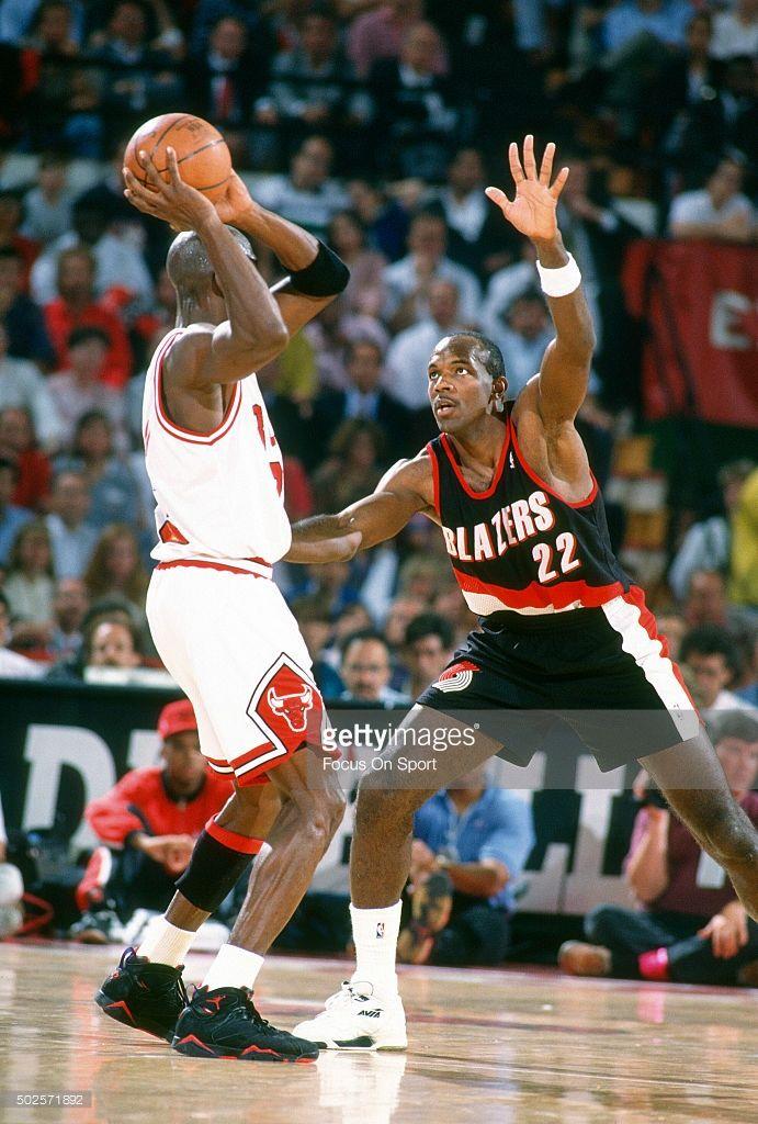 Clyde Drexler  22 of the Portland Trail Blazers guards Michael Jordan  23  of the Chicago Bulls during an NBA basketball game circa 1992 at Chicago  Stadium ... 413e8b8c4