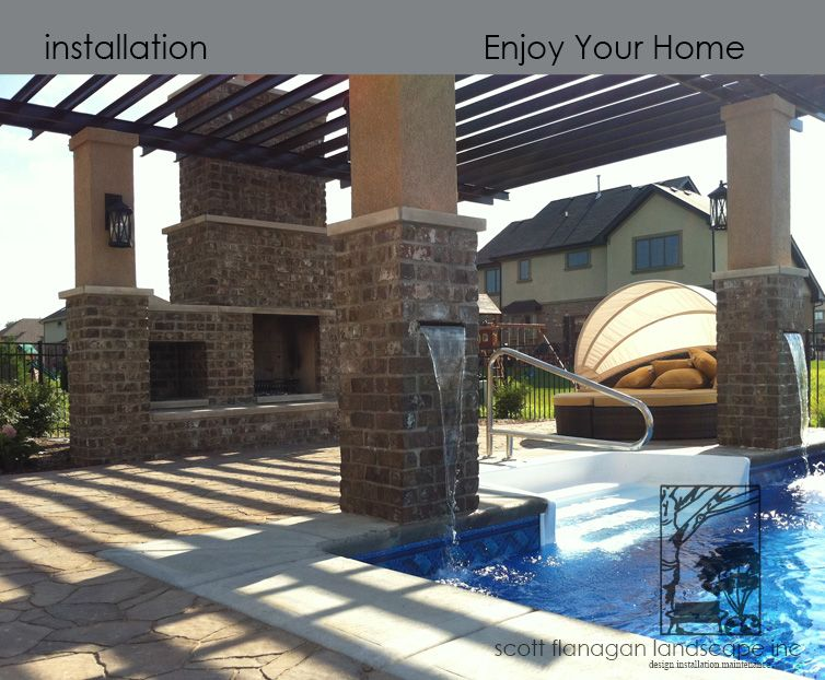 A paver patio with fireplace, pergola, and waterfalls into