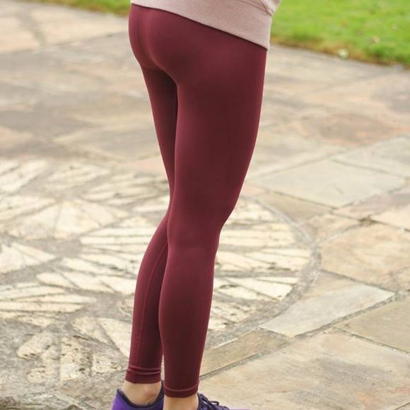 Zone In Tight Lululemon Color is Wine Berry (burgundy/maroon) Size 4 but I would say fits more like a 2! NWT lululemon athletica Pants Leggings