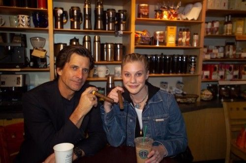 "So, here we have Dirk Benedict, who played Lt. Starbuck in the classic Battlestar Galactica, with Katee Sackhoff, who played Kara ""Starbuck"" Thrace in the modern Battlestar Galactica, in a Starbucks coffee shop. The mind reels."