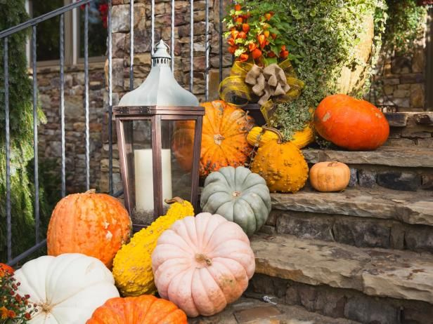 On the front steps, a multi-colored collection of pumpkins, gourds, squash and Chinese lanterns makes quite a statement when accented by candles and burlap bows.