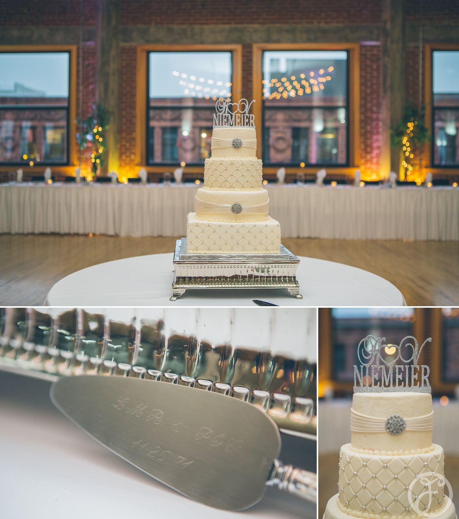 White and silver wedding cake windows on washington st louis