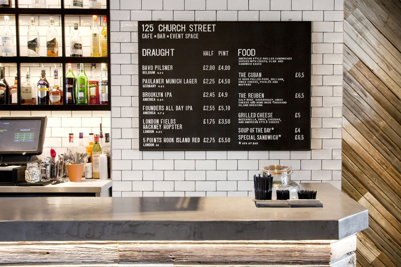 barnwood cladding to bar ribbed glass metal shelving concrete bar top 125