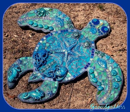 Almost all the pieces in this are handmade (by me) from polymer clay...lightweight on wedi board...