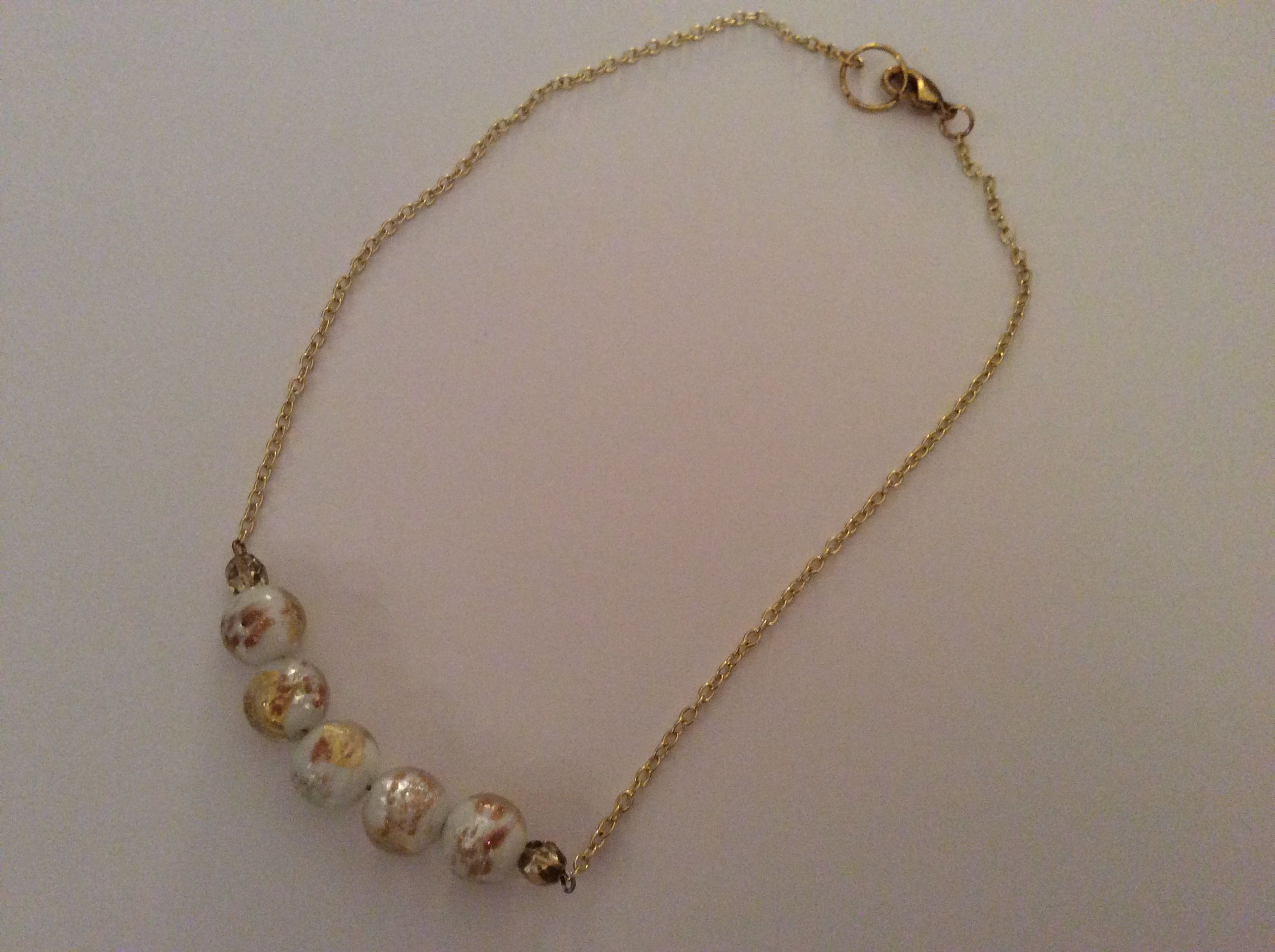 Gold necklace made with beads from carriegems