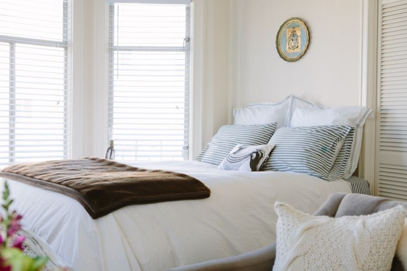 Studio Apartment Tour bed close up from lauren mizrahi's san francisco studio apartment