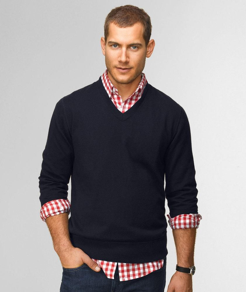 Casual preppy. V-neck sweater with pushed up sleeves, untucked ...