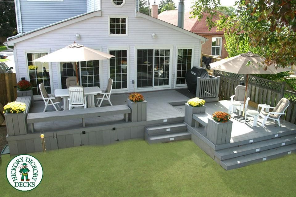 This Lovely Bi Level Deck Spans The Entire Back Of The Home And Is Built