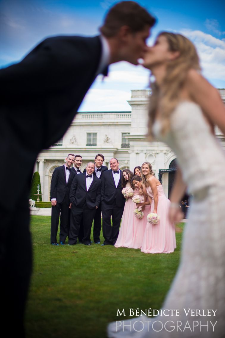 Kiss with bridal party Rosecliff  Mansion Newport RI