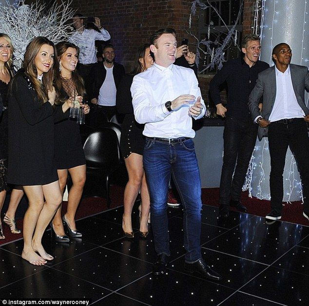 Wayne Rooney takes to the dance floor at the Manchester United Christmas Party...