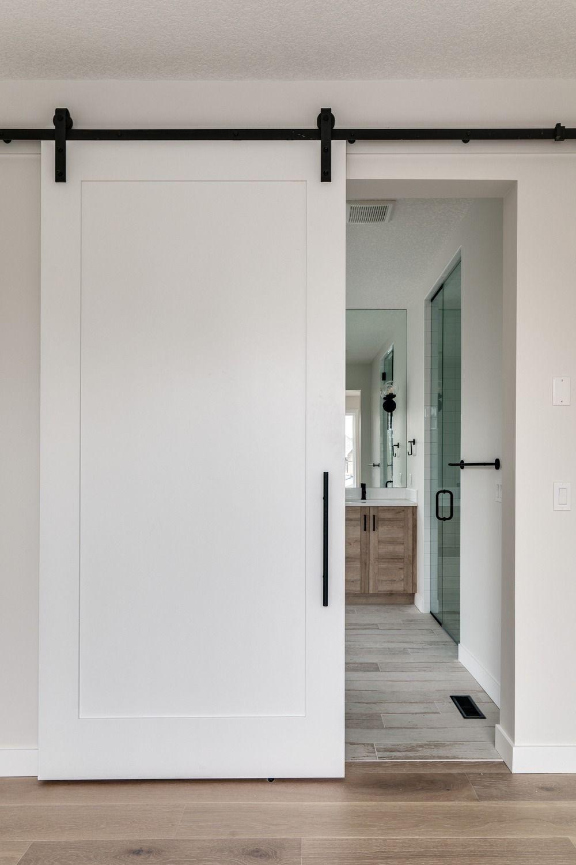 How Elegant Is This White Sliding Barn Door With Black Hardware