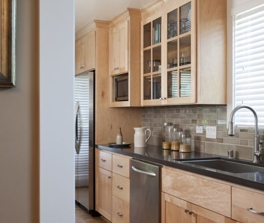 Image result for black countertops with maple colored ...