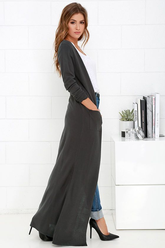 From fall to spring and back again, The Long Haul Dark Grey Long Cardigan Sweater will stick with you through all the seasons! This lightweight knit sweater has long sleeves and a stylish button front finished with patch pockets. Its extra-long silhouette is perfect for layering with jeans and sky-high heels!