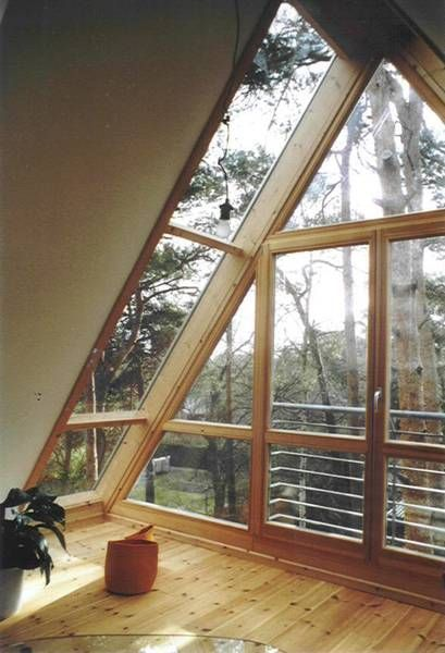 Wood Windows In The Roof Gable With A High Proportion Of Glass