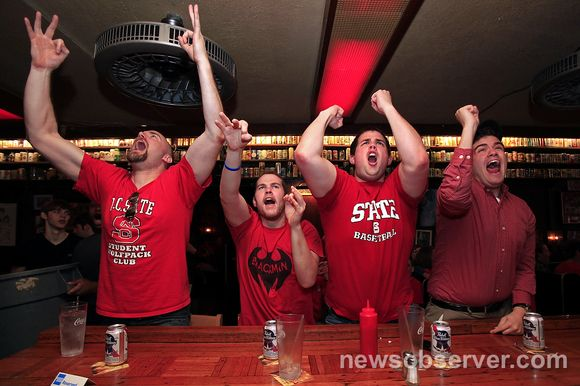 At The Players' Retreat, a sports bar in Raleigh, N.C. State fans celebrate the Wolfpack's 66-63 victory over Georgetown