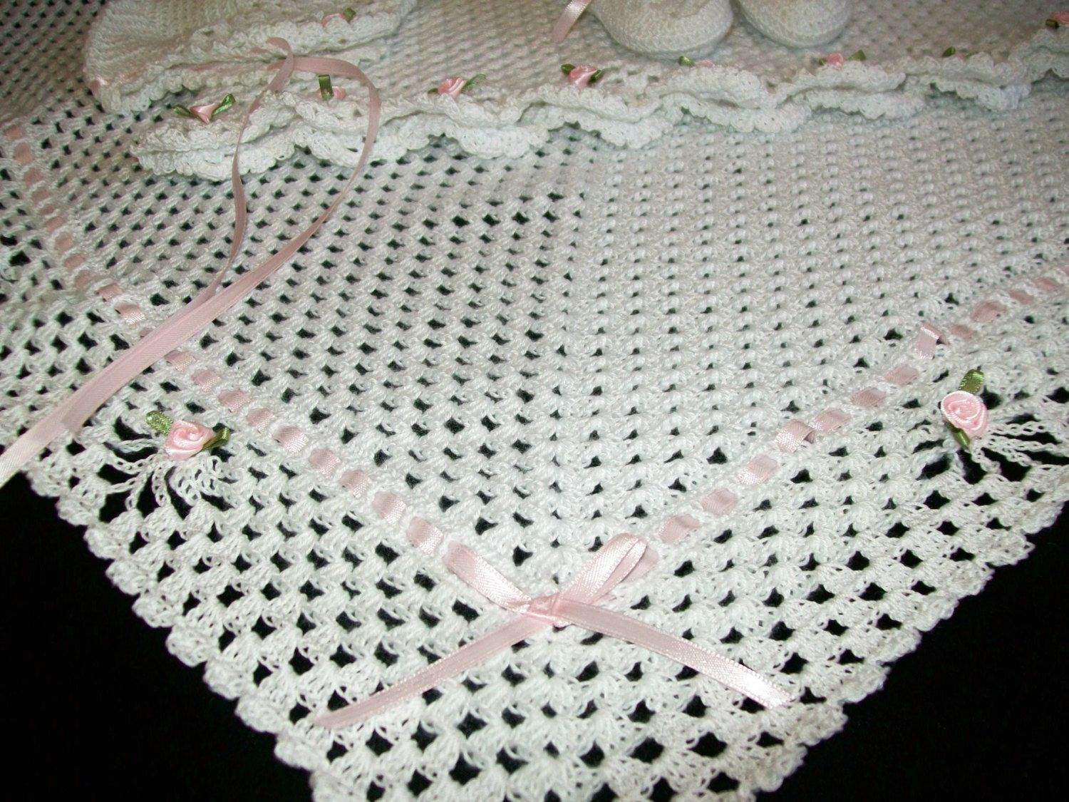 This is a Christening Baby Blanket white trimmed in pink, blue, yellow or green. Blanket is approximately 32 inches by 32 inches. This handmade blanket can last for generations and can be used for any occasion.  •Made with over 2,000 yards of cotton crochet thread •Heirloom Quality Outfit •Worthy of passing down through generations •Workmanship is impeccable •Elegance and pride for any baby for gifting or your own baby  Recommend wash in gentle cycle in washer or hand washed in cold water…
